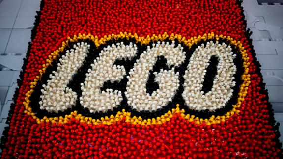 A Lego logo is pictured during the annual New York Toy Fair, at the Jacob K. Javits Convention Center on February 16, 2019 in New York City. (Photo by Johannes EISELE / AFP)