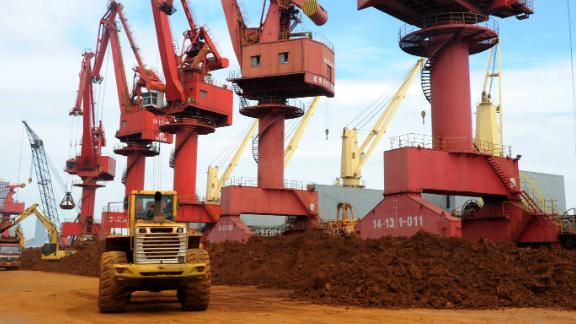 --FILE--A wheel loader piles up rare earth on a quay at the Port of Lianyungang in Lianyungang city, east China