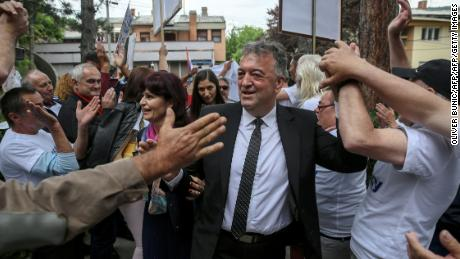 The former mayor of Brus, Milutin Jelicic is welcomed by supporters as he arrives at court on May 27 to attend his trial for sexual harassment.