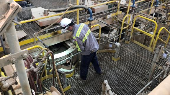 A worker checks on operations at the processing facility at the Mountain Pass rare earths mine in California.