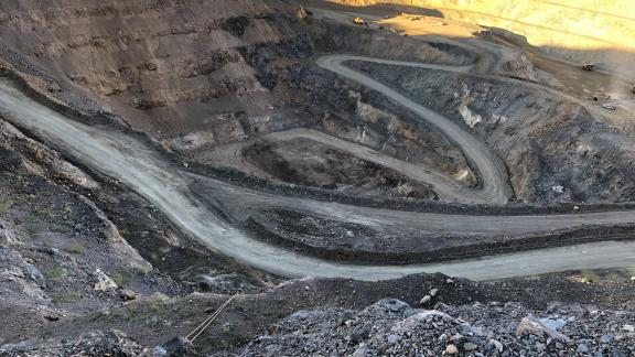 The pit at the MP Materials' Mountain Pass mine in California. It's the only operating mine in the United States that provides rare earths, ingredients that are key for producing high-tech products like cell phones and electric vehicles.
