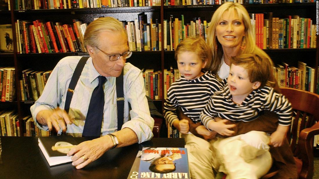"King -- with his wife, Shawn, and their children Chance and Cannon -- signs copies of his mystery novel ""Moon Over Manhattan"" in 2003."