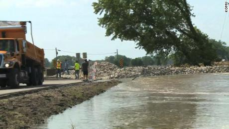 A crew works to repair a levee near Jefferson City, Missouri.