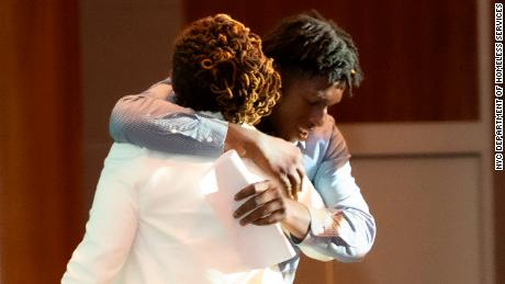 Student Ronaldino Crosdale gets a hug at Thursday night's honors.