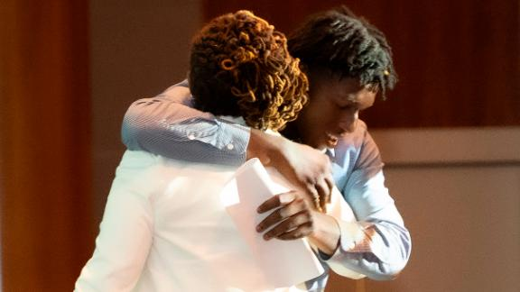 Student Ronaldino Crosdale gets a hug at Thursday night's honors.