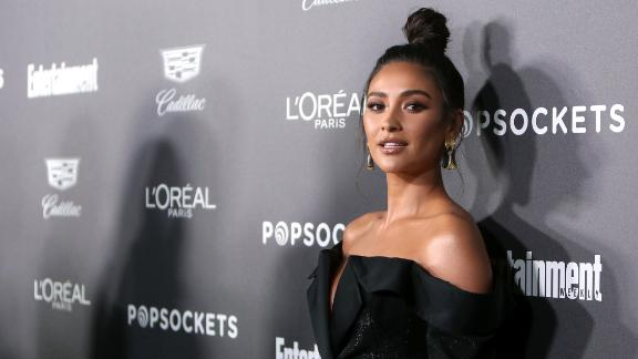 Actress Shay Mitchell revealed her pregnancy Friday.