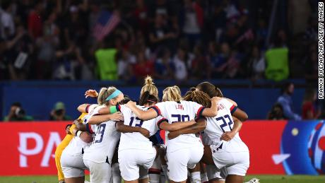 US players huddle at the end of the match.