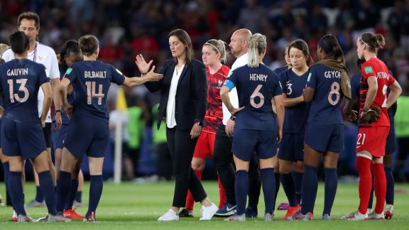 France coach Corinne Diacre consoled her side after the defeat.
