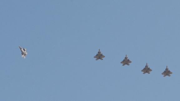 US Air Force F-22 Raptors fly in formation as they prepare to land at Al Udeid Air Base, Qatar, June 27, 2019.