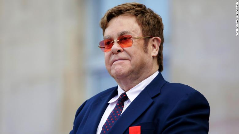 British singer-songwriter Elton John, seen addressing a crowd in the courtyard of the Elysee Palace in Paris, on June 21, 2019, will host a benefit concert on Fox on March 29.