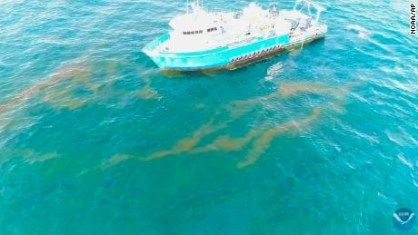 This September 2018 photo provided by NOAA shows a NOAA research vessel at a Taylor Energy production site in the Gulf of Mexico. A federally led study of oil seeping from the damaged platform found releases lower than other recent estimates, but contradicts the well owner's assertions about the amount and source of oil