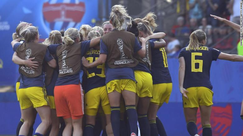 Team Sweden celebrates after beating Germany at the Women's World Cup Saturday.
