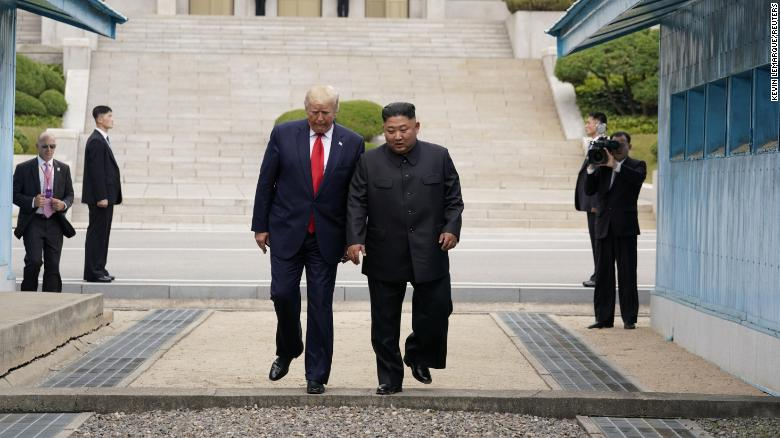 President Donald Trump takes a step with North Korean leader Kim Jong Un at the demilitarized zone separating the two Koreas, in Panmunjom, South Korea on June 30.