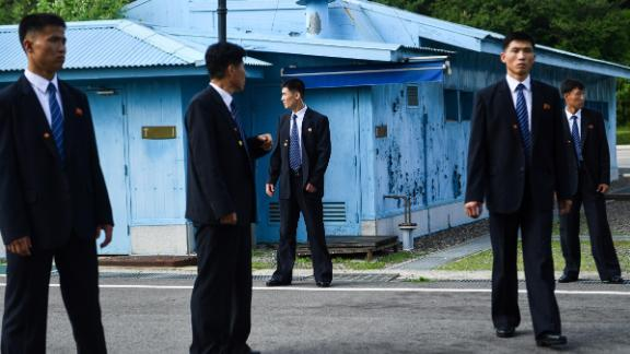 North Korean security agents keep watch south of the Military Demarcation Line that divides North and South Korea, as Trump and Kim meet in the Joint Security Area of Panmunjom in the Demilitarized zone on June 30.