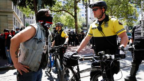 An unidentified protester and a police officer during a demonstration at Pioneer Courthouse Square in Portland, Oregon, on June 29, 2019.