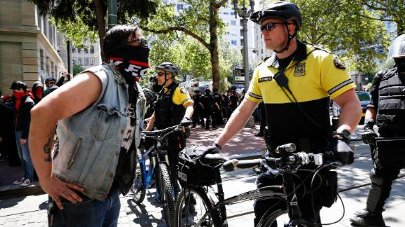 PORTLAND, OR - JUNE 29: An unidentified protester clashes with a police officer during a demonstration between the left and right at Pioneer Courthouse Square on June 29, 2019 in Portland, Oregon. Several groups from the left and right clashed after competing demonstrations at Pioneer Square, Chapman Square, and Waterfront Park spilled into the streets. According to police, medics treated eight people and three people were arrested during the demonstrations. (Photo by Moriah Ratner/Getty Images)