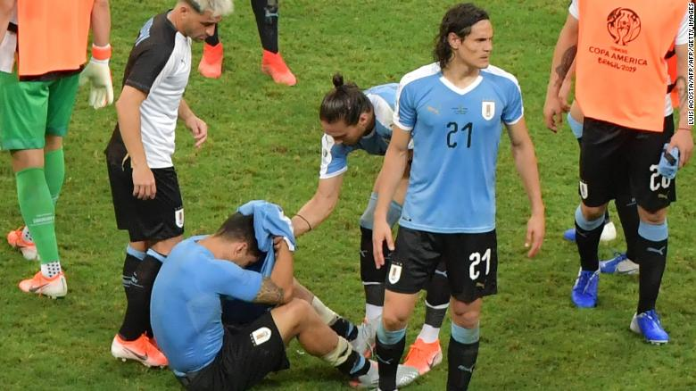 Luis Suarez, on the ground, was distraught after missing a penalty for Uruguay in the shootout against Peru at the Copa America.