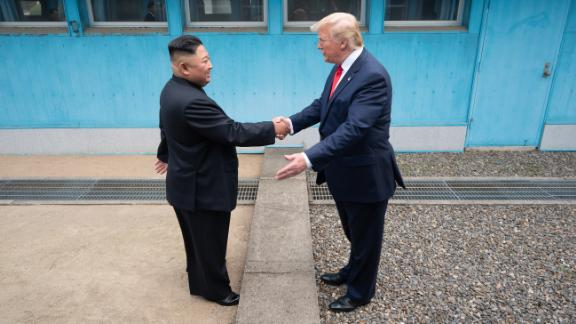 """Trump shakes hands with North Korean leader Kim Jong Un as the two <a href=""""https://www.cnn.com/2019/06/30/world/gallery/trump-kim-north-korea/index.html"""" target=""""_blank"""">meet at the Korean Demilitarized Zone</a> in June 2019. Trump briefly stepped over into North Korean territory, becoming the first sitting US leader to set foot in the nation. Trump said he invited Kim to the White House, and both leaders agreed to restart talks after nuclear negotiations stalled."""