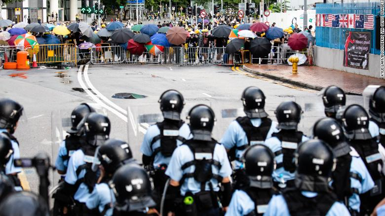 Demonstrators stand off against riot police early Monday.