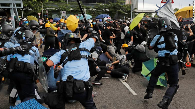 Riot police try to disperse protesters on the anniversary of Hong Kong's handover to China.