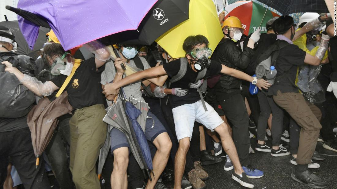 Protesters face police on July 1.