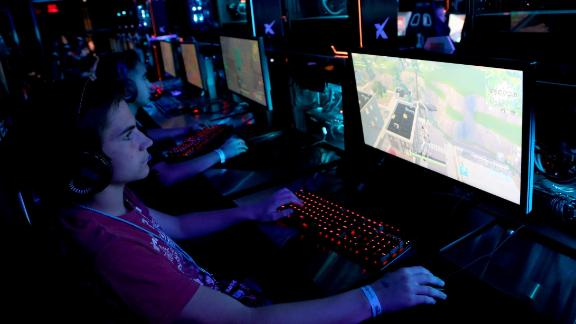 """Gamers play """"Fortnite"""" at the HyperX Esports Arena Las Vegas in Las Vegas, Nevada. Simon Property Group is partnering with  Allied Esports to create lounges for competitive video game events at its malls."""