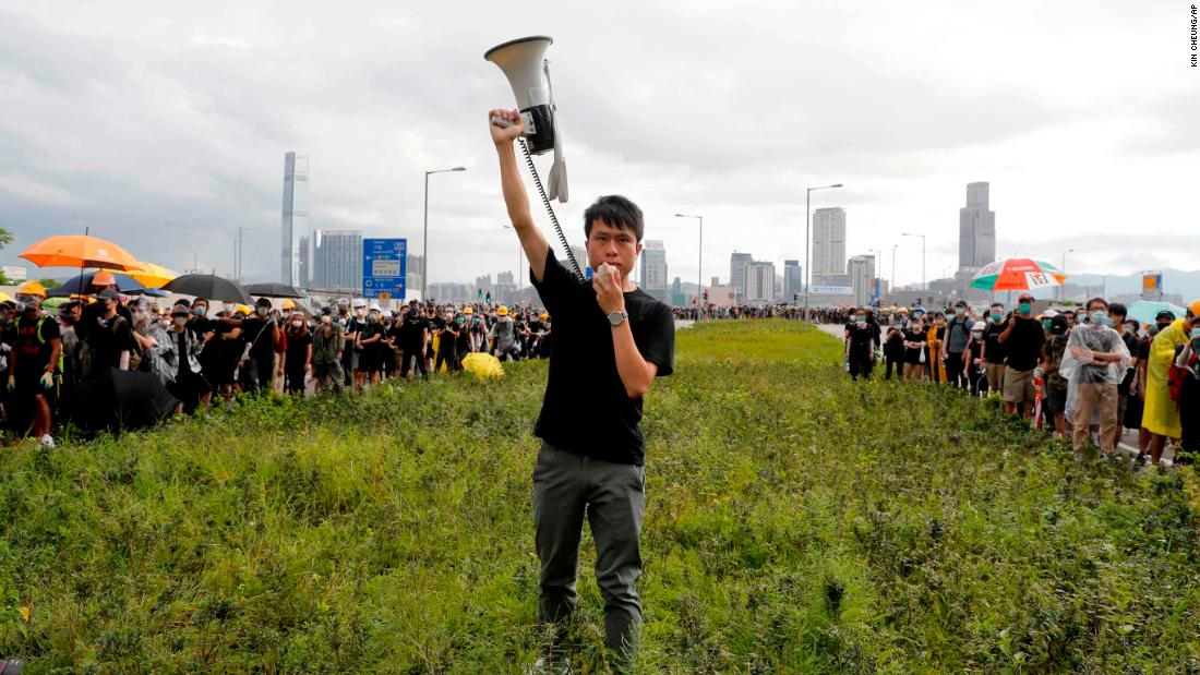 Pro-democracy lawmaker Roy Kwong rallies demonstrators with a megaphone on July 1.