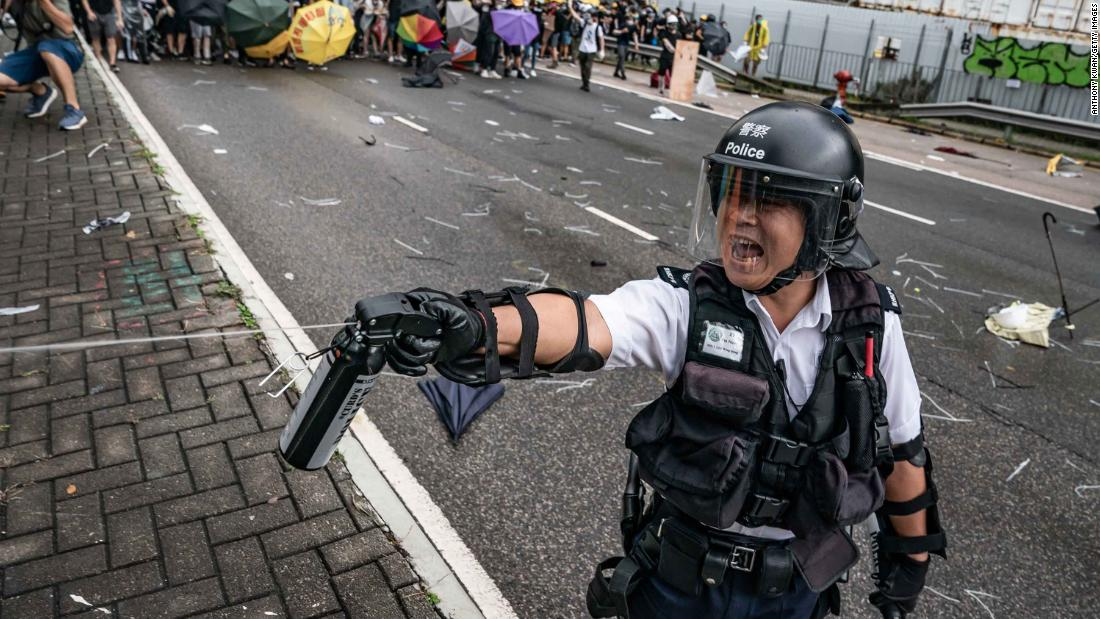 A police officer uses pepper spray during a clash with protesters on July 1.