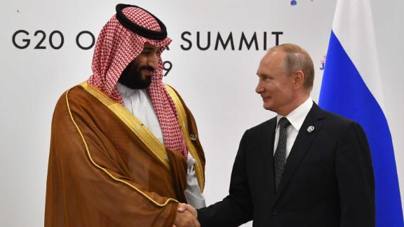 Russia's President Vladimir Putin (R) shakes hands with Saudi Arabia's Crown Prince Mohammed bin Salman during a meeting on the sidelines of the G20 Summit in Osaka on June 29, 2019. (Photo by Yuri KADOBNOV / POOL / AFP)        (Photo credit should read YURI KADOBNOV/AFP/Getty Images)