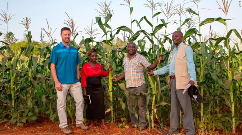 Broin with farmers in Kenya. Part of his nonprofit's mission is to teach better farming techniques to developing communities.