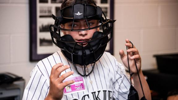 Josh Cordova tried on a new umpire mask, a gift from the Rockies.