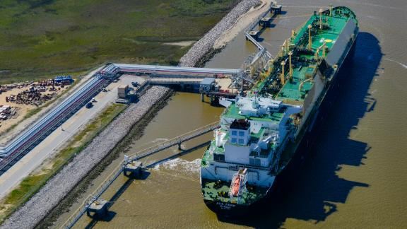 The Asia Vision LNG carrier ship sits docked at the Cheniere Energy Inc. terminal in this aerial photograph taken over Sabine Pass, Texas, U.S., on Wednesday, Feb. 24, 2016. Cheniere said in a statement last month. Cheniere Energy Inc. expects to ship the first cargo of liquefied natural gas on Wednesday to Brazil with another tanker to be loaded a few days later, marking the historic start of U.S. shale exports and sending its shares up the most in more than a month. Photographer: Lindsey Janies/Bloomberg via Getty Images