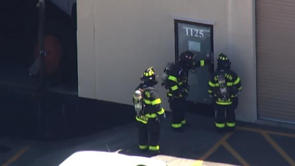 Firefighters check a Facebook mailing facility in California for the possible presence of sarin.
