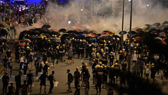 Police fire tear gas at protesters near the government headquarters in Hong Kong on July 2, 2019, on the 22nd anniversary of the city's handover from Britain to China. - Hundreds of protesters stormed Hong Kong's parliament late on July 1 as the territory marked its China handover anniversary, ransacking the building and daubing its walls with graffiti as the city plunged into unprecedented depths of political chaos. (Photo by Anthony WALLACE / AFP)        (Photo credit should read ANTHONY WALLACE/AFP/Getty Images)