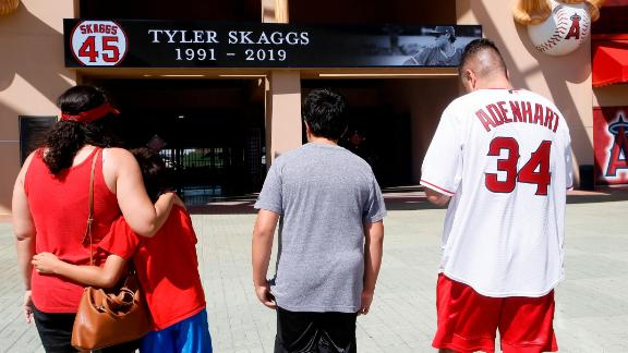 Ben Villa, his wife, Cindy, left, with their sons' Alex, second from left, and Benji give their condolences for pitcher Tyler Skaggs at Angel Stadium.