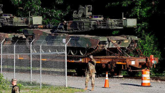 Military police walk near Abrams tanks on a flat car in a rail yard, Monday, July 1, 2019, in Washington, ahead of a Fourth of July celebration that President Donald Trump says will include military hardware. (AP Photo/Patrick Semansky)