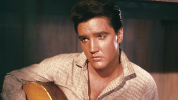 A portrait of Elvis Presley holding an acoustic guitar circa 1956.  (Photo by Archive Photos/Getty Images)