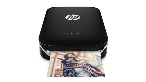 HP Sprocket Portable Photo Printer ($129.85; amazon.com): The HP Sprocket Portable Photo Printer is the ultimate photo album making, room decorating device. This miniature printer lets you print photos straight from your smartphone. Just queue up your pictures and watch them print onto 2x3-inch paper with an adhesive back. You can also decorate your photos before they print or share custom photo albums with friends.