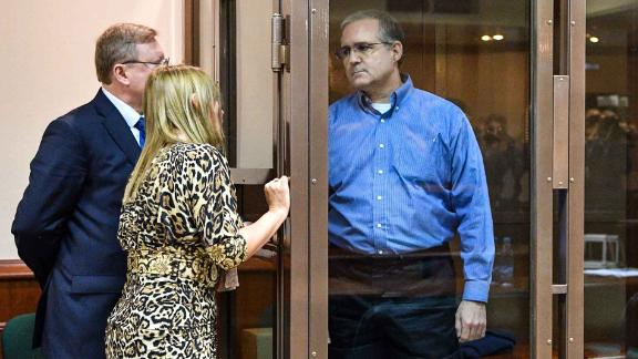 Paul Whelan, a former US Marine accused of espionage and arrested in Russia, listens to his lawyers while standing inside a defendants