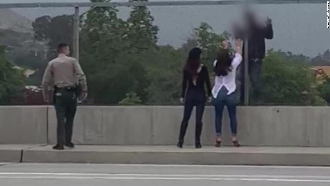 They saw a man about to jump off a highway overpass. Cell phone video captured what happened next.