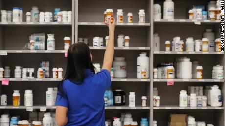 "MIDVALE, UT - SEPTEMBER 10: A pharmacy technician grabs a bottle of drugs off a shelve at the central pharmacy of Intermountain Heathcare on September 10, 2018 in Midvale, Utah. IHC along with other hospitals and philanthropies are launching a nonprofit generic drug company called ""Civica Rx"" to help reduce cost and shortages of generic drugs.  (Photo by George Frey/Getty Images)"