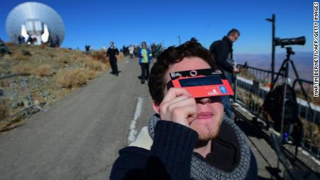A tourist tries special glasses at Chile's La Silla European Southern Observatory ahead of the eclipse.