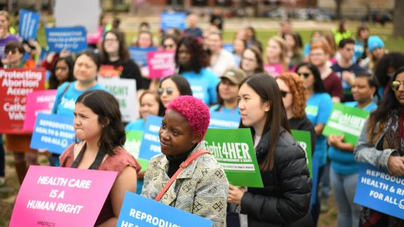 """WASHINGTON, DC - MARCH 29: People attend a """"Fight4Her"""" pro-choice rally in front of the White House at Lafayette Square on March 29, 2019 in Washington, DC. A coalition of NARAL Pro-Choice America, Planned Parenthood and Population Connection Action Fund gathered to demand the end of the"""