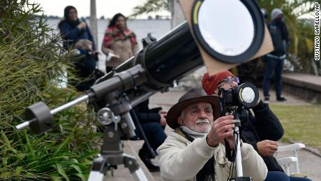 A man takes pictures of a total solar eclipse in Chascomus, Argentina.