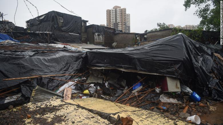 Shanty homes lay in ruins on Tuesday after a wall collapsed on them in Mumbai.