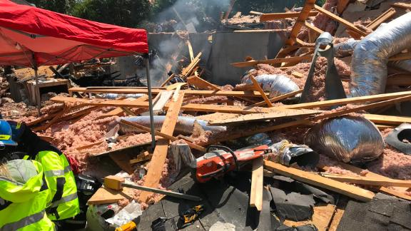 A person was rescued from under the debris on Tuesday, officials said.