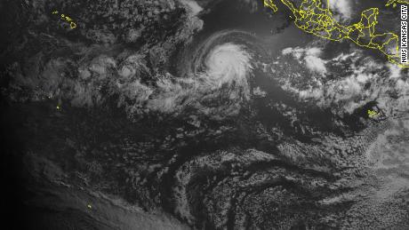 Satellite images show a total solar eclipse the moment it passed over a hurricane.