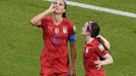 Alex Morgan celebrates after scoring a goal against England on Tuesday.