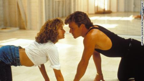 "Patrick Swayze and Jennifer Grey in the movie ""Dirty Dancing"" remind us to be present with and focused on your partner as a resolution for the new year."