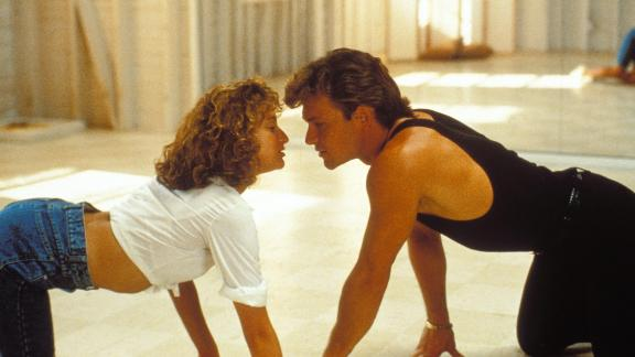 """Patrick Swayze and Jennifer Grey in the movie """"Dirty Dancing"""" remind us to be present with and focused on your partner as a resolution for the new year."""